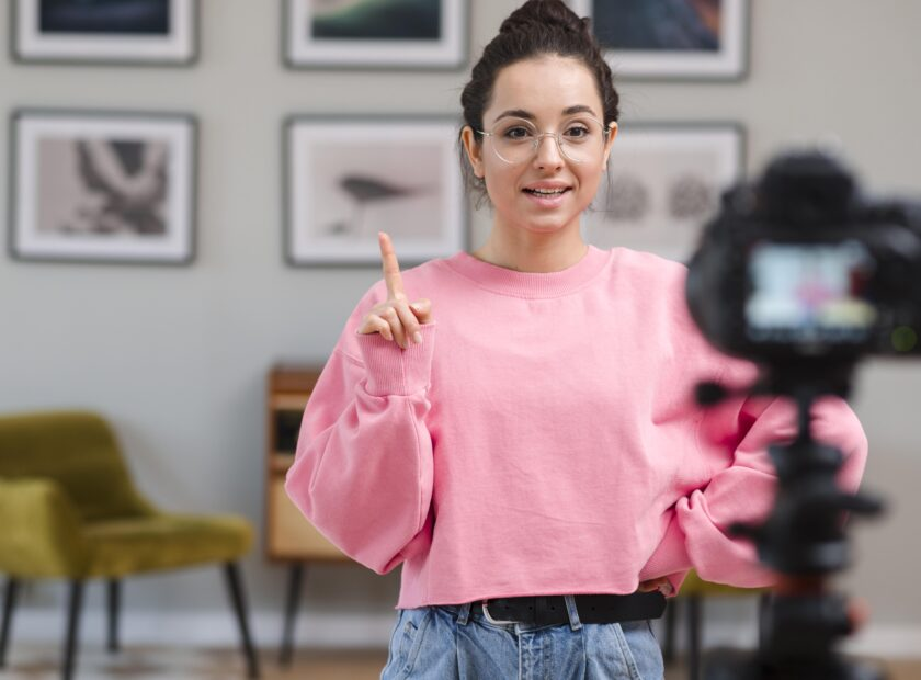 young woman recording video home scaled